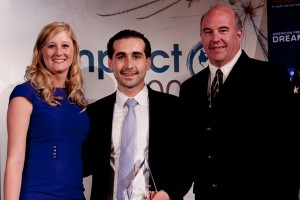 Ali Saad, center, poses with Sarah Green, co-founder of Empact, and Jeff Hoffman, co-founder of Priceline.com
