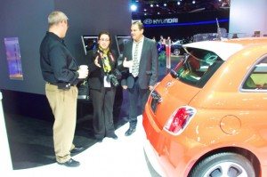 Andrew Mitter and videographer Liz Walker enjoy car talk with a Fiat representative
