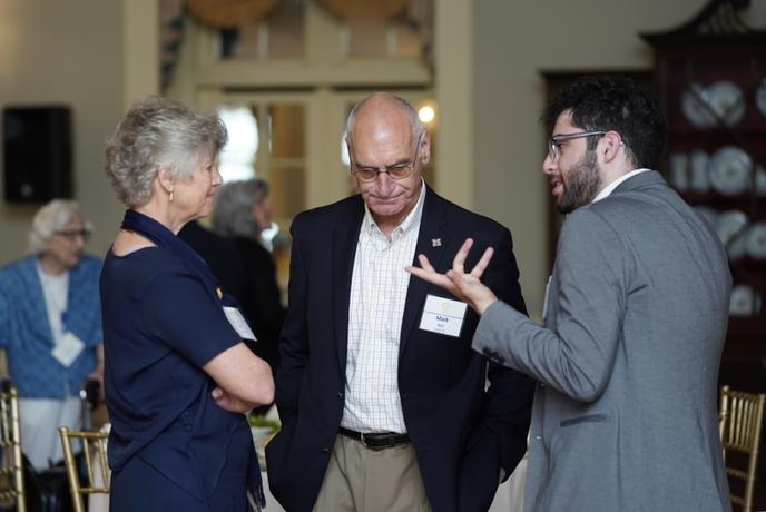 Lee Gorman (left) and her husband, Mark Ritz, speaking with UM-Dearborn student, Mohamad Jaafar