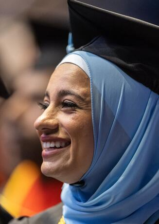 Woman smiling at commencement