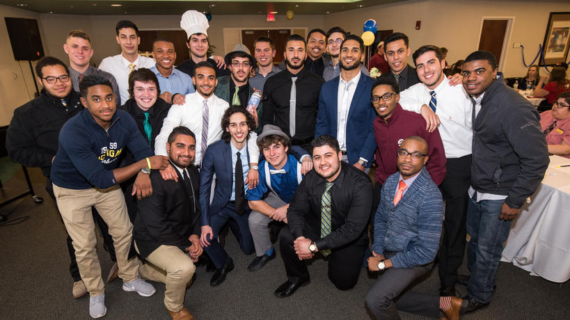 Delta Sigma Phi members at their annual Miss Maize & Blue fundraiser.
