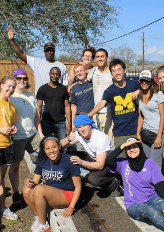 Students volunteering outdoors