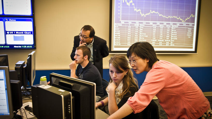 Professor working with students in the BELL lab.
