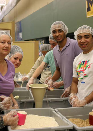 Students scooping rice for a volunteer project