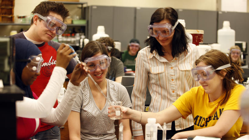 A group of students working together in a lab.