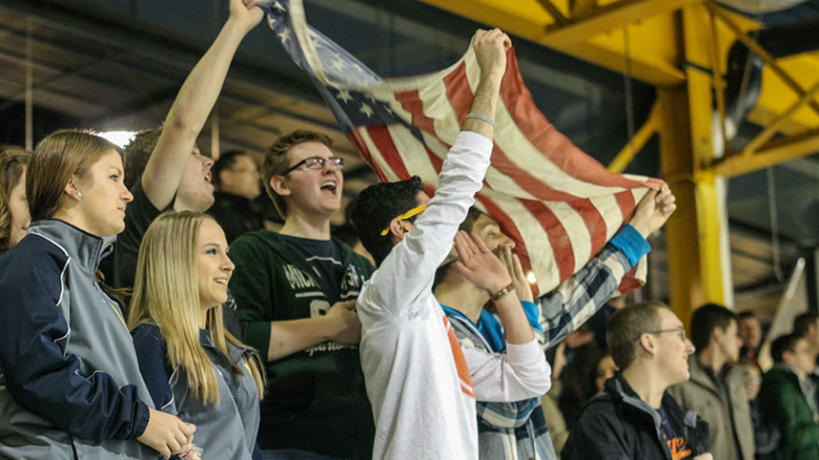 Students cheering at a sporting event