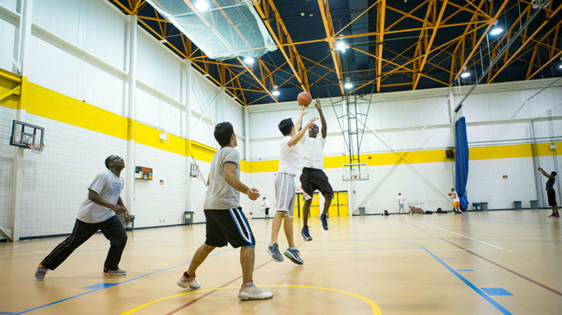 Students playing basketball in the Fieldhouse