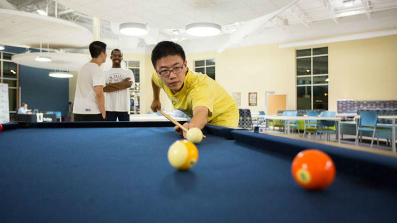 Student playing pool in the Union