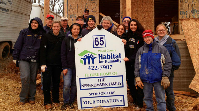 A group of UM-Dearborn volunteers participating in a Habitat for Humanity project