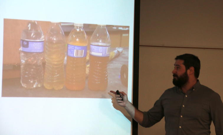 Evan Redmond presents to the class on his team's findings on which water lines to replace in Flint.