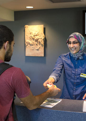 A student receiving their MCard at the University Center