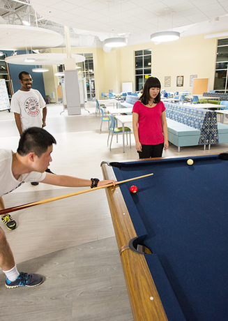 Students playing pool at the Union at Dearborn