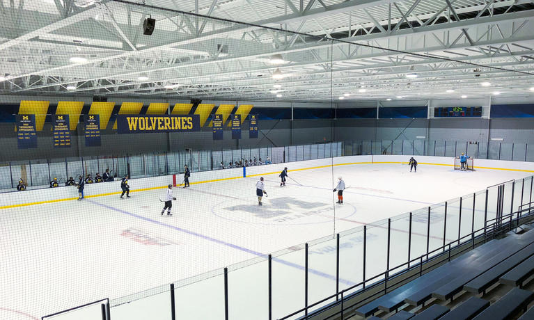 The UM-Dearborn Fieldhouse gets new hockey boards.