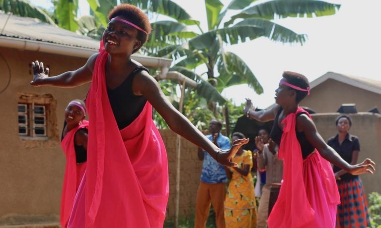 CASL faculty members traveled to Rwanda this summer. Here are dancers performing at a Reconciliation Village.