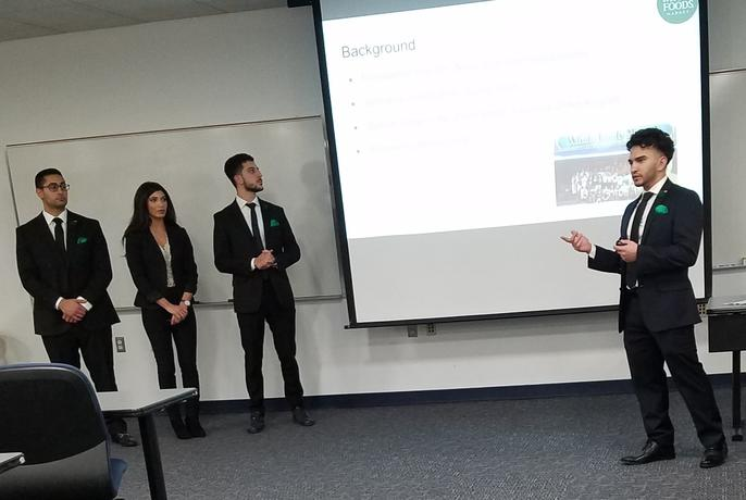 Students give ad campaign presentations in Lecturer Tim Hartge's course.