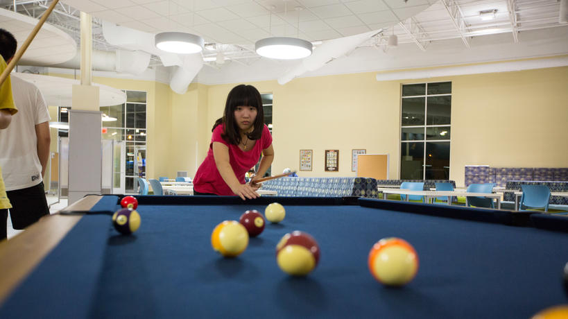 Students playing pool in the Union at Dearborn