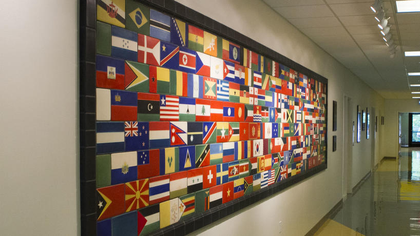 A collage of international flags on the wall of the University Center