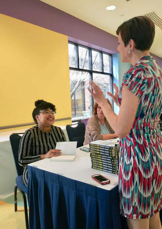 Amy Brainer buys book