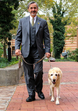 Chancellor Grasso and his very good dog outside the Administration Building.
