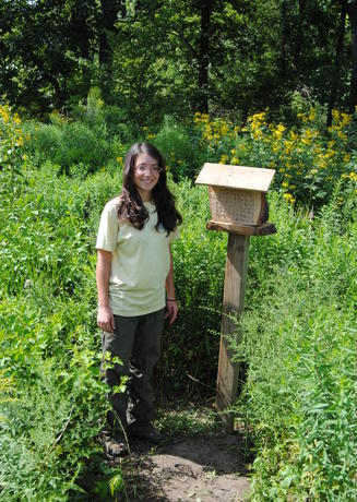EIC Sustainability Intern, Dana Wloch, and her insect hotel project