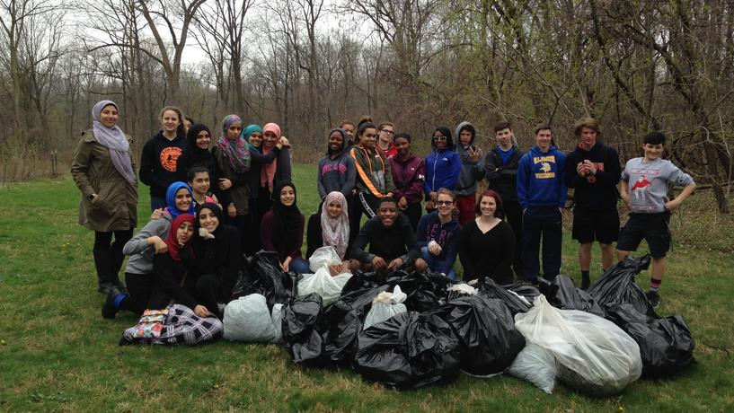 Edsel Ford High School Students volunteer to pull garlic mustard from the Environmental Study Area