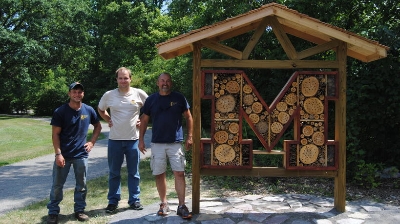 EIC staff member Mike Perrin and Sustainability Interns Brandon Thomas and Jacob Sawecki stand proudly beside the completed Insect Hotel,