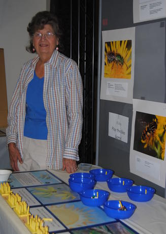 EIC volunteer Sandy standing next to her insect exhibit