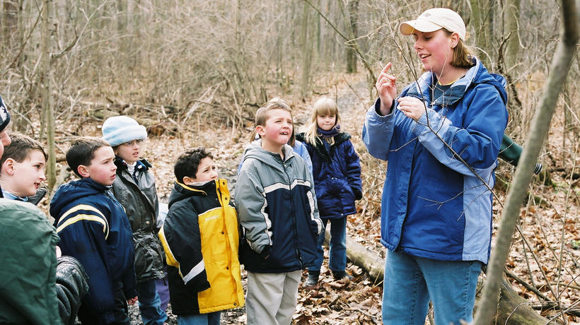 Kathy Evans demonstrates how to identify maple trees during Maple Syrup Science Program