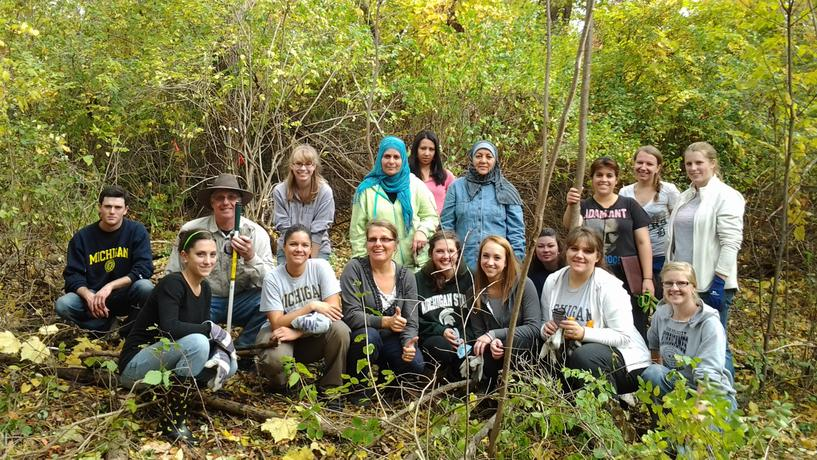 Lecturer Pat Hartshorn and her students volunteer to remove invasive plant species from the Environmental Study Area