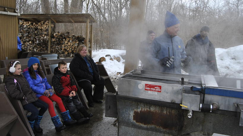 EIC Program Supervisor Rick Simek demonstrates how to make maple syrup at a sap stove