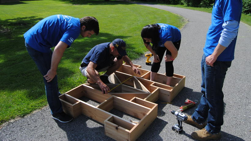 Ford volunteers help assemble the Go Blue! Insect Hotel