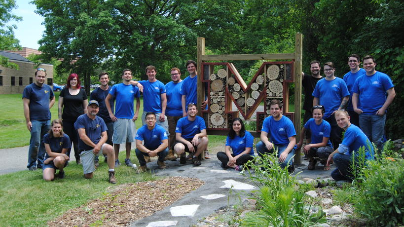 Ford volunteer work crew is all smiles after a full day working in the Pollinator Garden