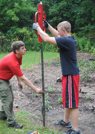 Volunteers install fence posts in the Environmental Study Area