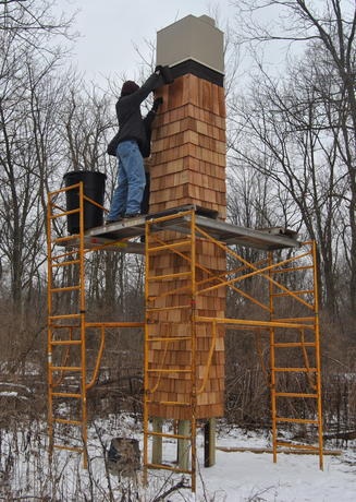 Volunteers install shingles on Chimney Swift Tower in Environmental Study Area