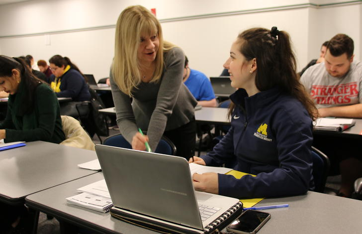 Lecturer Patty Graybeal talks to Brooke Spiegel about the study guide for next week's accounting test.