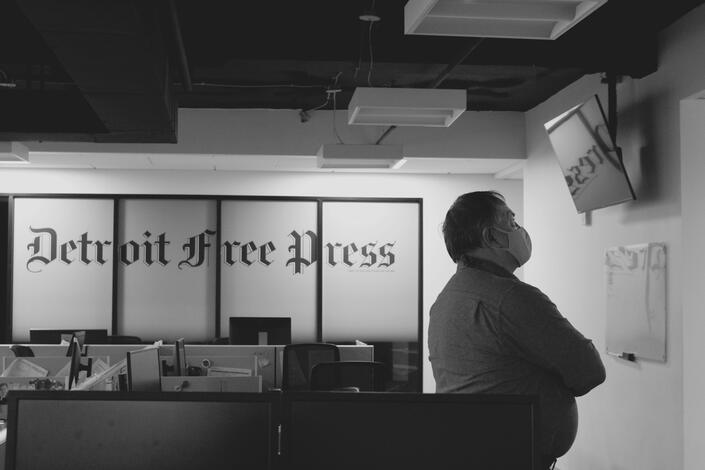 UM-Flint Professor Thomas Wrobel watches election coverage at the Detroit Free Press. (Photo by Madisyn Bradow)