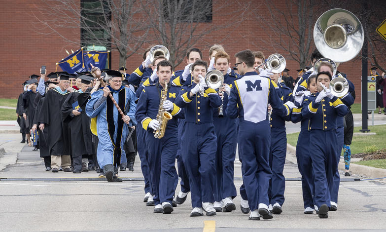 The Michigan Marching Band leads the procession into the Fieldhouse.