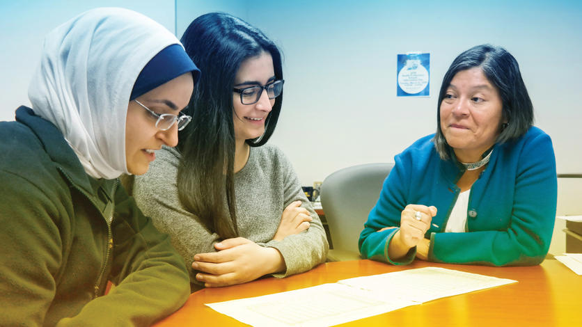 Health Professions Adviser Tahnee Prokopow (right) helps keep pre-med student Fatima Saad (center) focused with the support of mentor Mariam Ayyash. Photo by Lou Blouin.