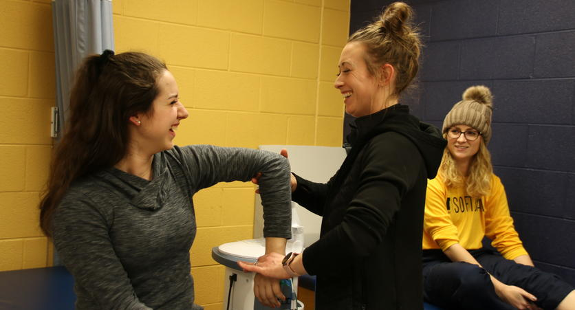 Brooke Spiegel and Athletic Trainer Kelsey Rasky