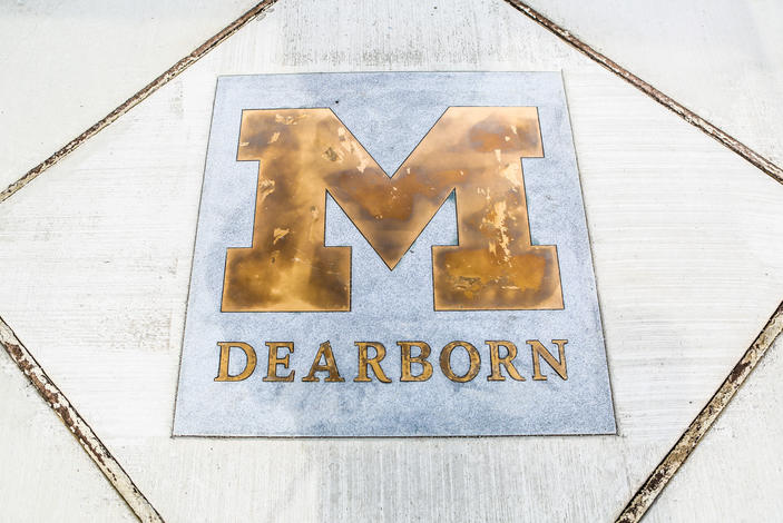 The UM-Dearborn Block M sidewalk inlay outside the University Center
