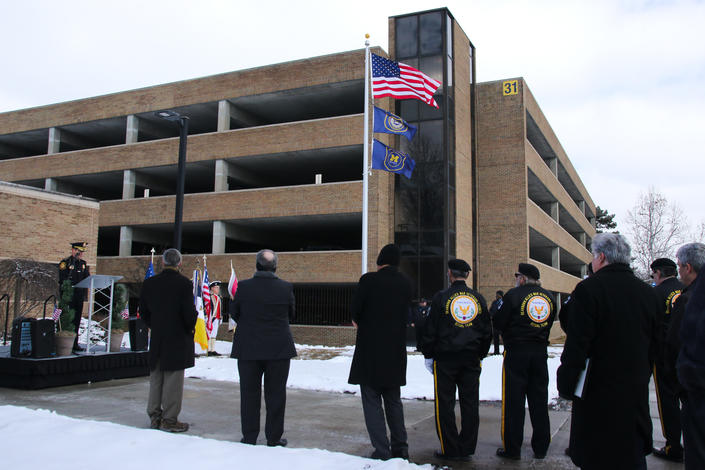 February 18, 2019: Chancellor Grasso helps to dedicate the new flagpole, along with the UM-Dearborn Police and Public Safety Department, outside of the Campus Support Services Building.