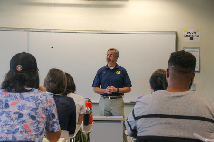 July 12, 2019: Chancellor Grasso speaks with REU program students from MIT, Pomona, Oberlin, Kenyon, U-M Ann Arbor, UM-Dearborn and others, on campus as the students presented their math research.