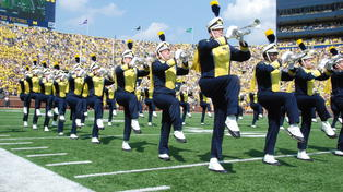 The Michigan Marching Band performing at the Big House