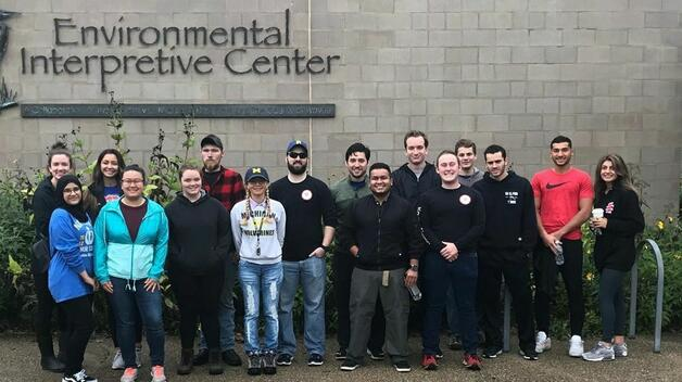 Beta Alpha Psi working at the Environmental Interpretive Center
