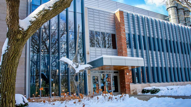 A snow-covered Natural Sciences Building on the UM-Dearborn campus.