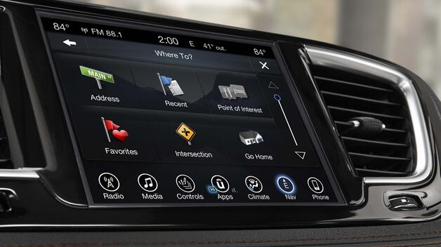 A close-up view of the infotainment dashboard touchscreen in the 2017 Chrysler Pacifica.