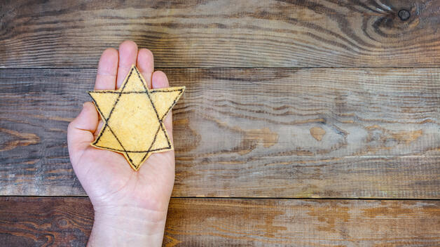A star of David held by a student who is interested in learning about the Holocaust