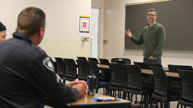 CASL faculty Paul Draus speaks to a group of officers during the Alternatives to Violent Force training on campus.