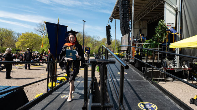 Spring 2021 CECS Master of Science in Human-Centered Design & Engineering graduate Hyunjoo Park walks to the stage to get recognized for her achievement. Photo/Austin Thomason