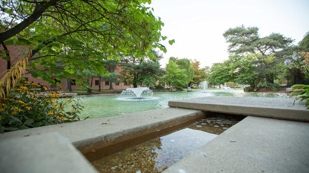 An evening view of Chancellor's Pond outside the Adminstration Building.